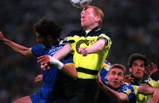Football. UEFA Champions League Final. Munich, Germany. 28th May 1997. Borussia Dortmund 3 v Juventus 1. Borussia Dortmund captain Matthias Sammer wins a header and clears from Mark Iuliano of Juventus.