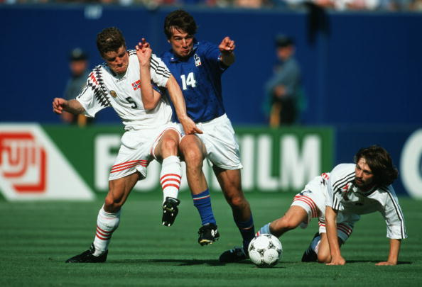 1994 World Cup Finals. New Jersey, USA. 23rd June 1994. Italy 1 v Norway 0. Italy's Nicola Berti battles for the ball with Norway's Stig Inge Bjornebye and Erik Mykland