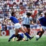 1986 World Cup Finals, Puebla, Mexico, 5th June, 1986, Italy 1 v Argentina 1, Argentina's Diego Maradona races between Italy's Antonio Di Gennaro and Fernando De Napoli