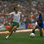 Saokov of Bulgaria runs down the wing past the stumbling Scireac of Italy