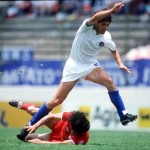 1986 World Cup Finals. Puebla, Mexico. 10th June, 1986. Italy 3 v South Korea 2. Italy's Antonio Di Gennaro leaps over the challenge of South Korea's Tae Hoo Lee.