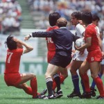 1986 World Cup Finals. Puebla, Mexico. 10th June, 1986. Italy 3 v South Korea 2. South Korea's Jung Moo Huh holds his head as he falls to the ground following a confrontation with Italy's Salvatore Bagni as the referee intervenes.
