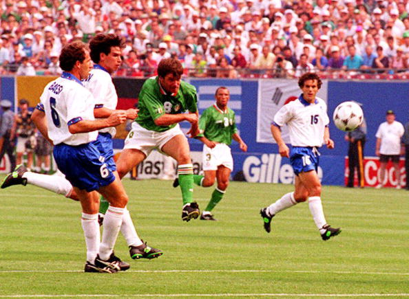 Ireland's Ray Houghton (C) watches his shot go in