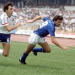 1986 World Cup Finals. Second Phase. Mexico City, Mexico. 17th June, 1986. France 2 v Italy 0. Italy's Alessandro Altobelli races for the ball with France's Maxime Bossis.