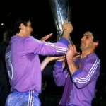 Camacho and Santi Uana of Real Madrid hold up the trophy after winning the UEFA Cup final match