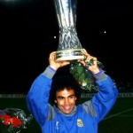 Hugo Sanchez of Real Madrid celebrates with the trophy aloft after winning the UEFA Cup Final
