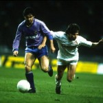 Santillana of Real Madrid holds off Bein of I.FC Cologne during the UEFA Cup Final Second Leg match