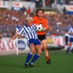 Peter Larsson of IFK Gothenburg controls the ball while Paul Sturrock of Dundee United moves in