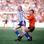 Football. UEFA Cup Final, Second Leg. Tannadice Park, Scotland. 20th May 1987. Dundee United 1 v IFK Gothenburg 1 (Gothenburg win 2-1 on aggregate). Gothenburg's Tord Holmgren is challenged by Dundee United's Paul Sturrock.