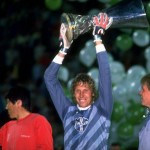R. Vollborn of Bayer Leverkusen holds the trophy up in victory after the UEFA Cup Final