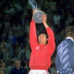 Cha-Bum-Kun of Bayer Leverkusen holds the trophy up in victory after the UEFA Cup Final