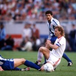 Football. UEFA Cup Final, Second Leg. Germany. 18th May 1988. Bayer Leverkusen 3 v Espanol 0 (after extra time, 3-3 on aggregate, Bayer win 3-2 on penalties). Bayer Leverkusen captain Wolfgang Rolff is tackled by Espanol's Osada.