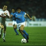 Hartmann of Stuttgart moves in to tackle Diego Maradona of Napoli during the UEFA Cup Final