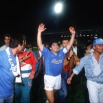 Football. UEFA Cup Final, Second Leg. Naples, Italy. 17th May 1989. Napoli 2 v VfB Stuttgart 1 (Napoli win 5-4 on aggregate). Napoli captain Diego Maradona celebrates with supporters at the end of the match.