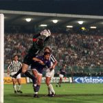 Football. UEFA Cup Final, Second Leg. Florence, Italy. 16th May 1990. Fiorentina 0 v Juventus 0 (Juventus win 3-1 on aggregate). Juventus goalkeeper Stefano Tacconi catches the ball under pressure from Fiorentina's Alberto Di Chiara.
