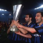 Football. UEFA Cup Final, Second Leg. Rome, Italy. 22nd May 1991. Roma 1 v Inter Milan 0 (Inter win 2-1 on aggregate). Inter Milan captain Giuseppe Bergomi (left) and team-mate Sergio Battistini hold the trophy during celebrations.