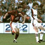 Bayern Munich striker Jurgen Klinsmann (R) is chal