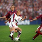 Football. UEFA Cup Final, Second Leg. France. 15th May 1996. Bordeaux 1 v Bayern Munich 3 (Bayern Munich win 5-1 on aggregate). Bayern Munich's Jurgen Klinsmann is challenged by Bordeaux's Philippe Lucas.