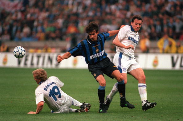 Football. UEFA Cup Final, Second Leg. Milan, Italy. 21st May 1997. Inter Milan 1 v Schalke 04 0 (1-1 on aggregate, after extra time, Schalke win 4-1 on penalties). Inter Milan's Massimo Paganin is challenged by Schalke's Buskens (19) and Marc Wilmots.