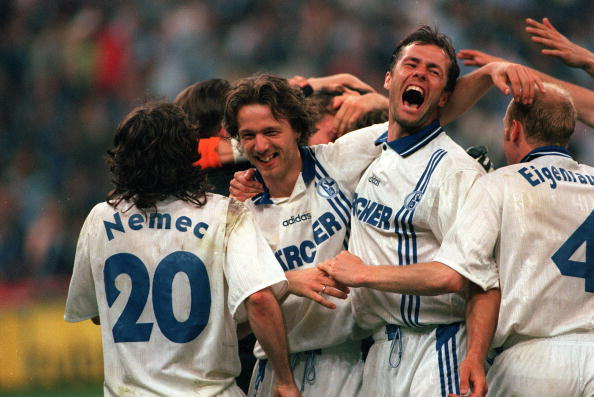 Football. UEFA Cup Final, Second Leg. Milan, Italy. 21st May 1997. Inter Milan 1 v Schalke 04 0 (1-1 on aggregate, after extra time, Schalke win 4-1 on penalties). Schalke's Thomas Linke (second left) and Johan De Kock are pictured with their team-mates i