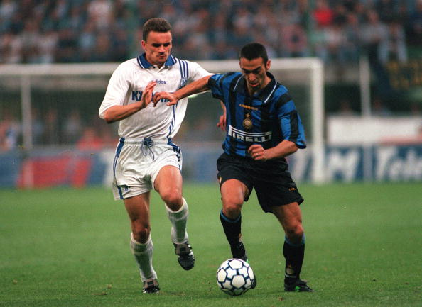 Football. UEFA Cup Final, Second Leg. Milan, Italy. 21st May 1997. Inter Milan 1 v Schalke 04 0 (1-1 on aggregate, after extra time, Schalke win 4-1 on penalties). Inter Milan's Youri Djorkaeff is challenged by Schalke's Martin Max.