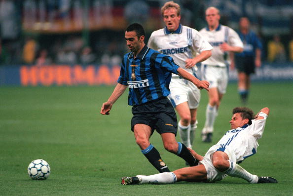 Football. UEFA Cup Final, Second Leg. Milan, Italy. 21st May 1997. Inter Milan 1 v Schalke 04 0 (1-1 on aggregate, after extra time, Schalke win 4-1 on penalties). Inter Milan's Youri Djorkaeff evades a sliding tackle from Schalke's Olaf Thon.