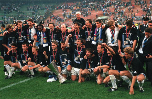 Football. UEFA Cup Final, Second Leg. Milan, Italy. 21st May 1997. Inter Milan 1 v Schalke 04 0 (1-1 on aggregate, after extra time, Schalke win 4-1 on penalties). The Schalke players and officials celebrate with the trophy.