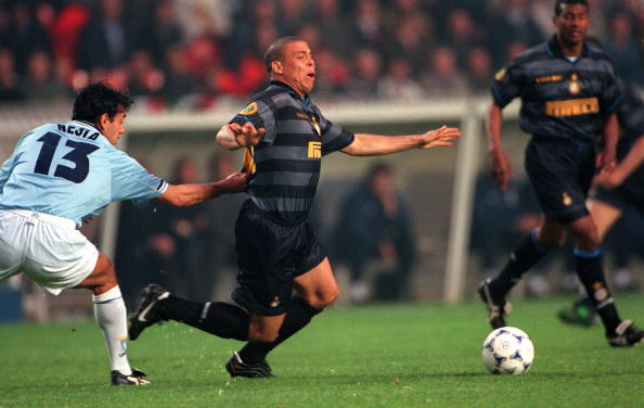 Football. UEFA Cup Final. Paris, France. 6th May 1998. Inter Milan 3 v Lazio 0. Inter Milan's Ronaldo has his shirt pulled by Lazio's Alessandro Nesta.