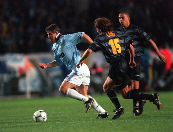 Football. UEFA Cup Final. Paris, France. 6th May 1998. Inter Milan 3 v Lazio 0. Lazio's Vladimir Jugovic moves past Inter Milan's Benoit Cauet.