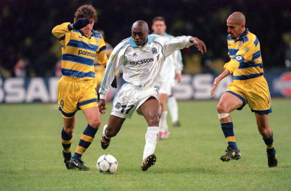 Football. 1999 UEFA Cup Final. Moscow. 12th May, 1999. Parma 3 v Marseille 0. Marseille's Cyril Domoraud is challenged by Parma's Hernan Crespo (left) and Juan Veron (right).