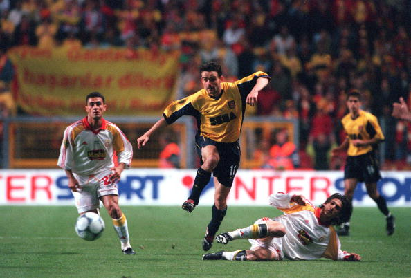 Football. UEFA. Cup Final. 17th. May, 2000. Copenhagen, Denmark. Galatasaray bt. Arsenal, 4-1 on penalties. (0-0 aet). Arsenal's Marc Overmars beats Hasan Sas, and Davala Umit of Galatasaray.