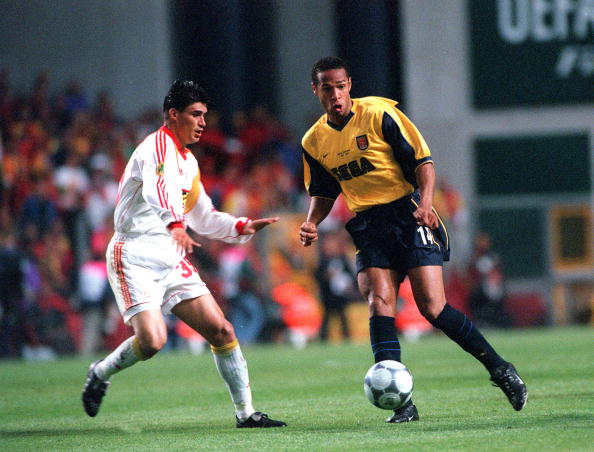 Football. UEFA. Cup Final. 17th. May, 2000. Copenhagen, Denmark. Galatasaray bt. Arsenal, 4-1 on penalties. (0-0 aet). Arsenal's Thierry Henry, closely watched by Galatasaray's Capone.