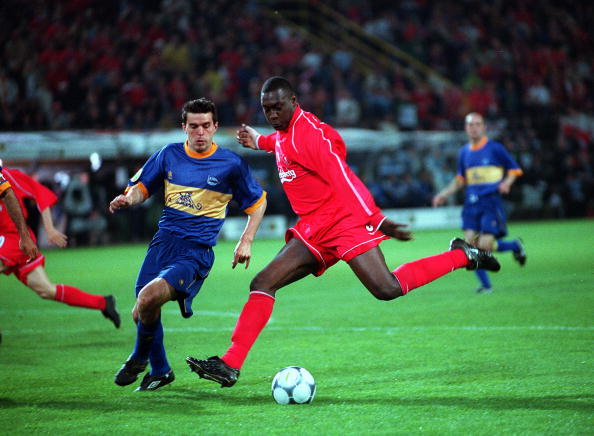 Football. UEFA Cup Final. 16th May 2001. Dortmund, Germany. Liverpool 5 v Deportivo Alaves 4 (on Golden Goal). Liverpool's Emile Heskey prepares to shoot for goal as Cosmin Contra of Alaves moves in.