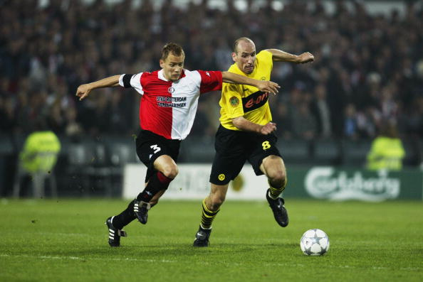 Tomasz Rzasa of Feyenoord and Jan Koller of Borussia Dortmund