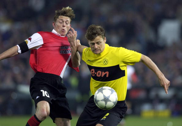 PF Football. UEFA Cup Final. Rotterdam. Holland. 8th May 2002. Feyenoord 3 v Borussia Dortmund 2. Feyenoord's Jon Dahl Tomasson with Dortmund's Christian Worns.