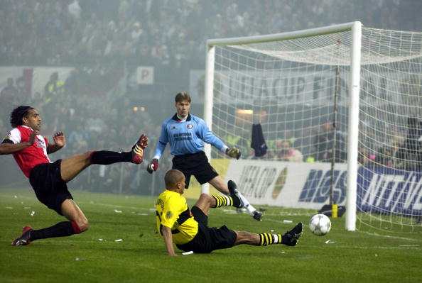 PF Football. UEFA Cup Final. Rotterdam. Holland. 8th May 2002. Feyenoord 3 v Borussia Dortmund 2. Feyenoord's Pierre van Hooijdonk kicks the ball into touch while Dortmunds Marcio Amoroso misses the ball.
