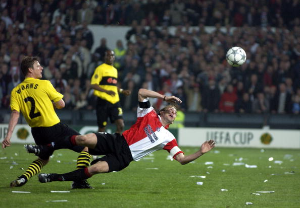 PF Football. UEFA Cup Final. Rotterdam. Holland. 8th May 2002. Feyenoord 3 v Borussia Dortmund 2. Feyenoord's Paul Bosvelt is challenged by Dortmunds Christian Worns.