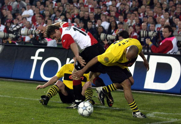 PF Football. UEFA Cup Final. Rotterdam. Holland. 8th May 2002. Feyenoord 3 v Borussia Dortmund 2. Dortmunds Dede with Feyenoord's Johan Elmander.