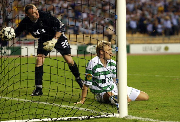 A dejected Ulrik Laursen and Robert Douglas of Celtic after the winning goal goes in