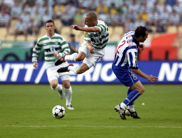 PF Football. UEFA Cup Final. Seville, Spain. 21st May 2003. Celtic 2 v FC Porto 3 ( after Extra Time). Celtic's Henrik Larsson in mid air after a challenge from Porto's Jorge Costa.