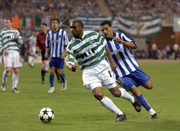 PF Football. UEFA Cup Final. Seville, Spain. 21st May 2003. Celtic 2 v FC Porto 3 ( after Extra Time). Celtic's Didier Agathe with Porto's Derlei.