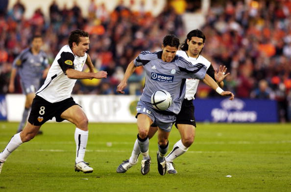 BT Sport. Football. UEFA Cup Final. Gothenburg. 19th May 2004. Valencia CF 2 v Olympic Marseille 0. Marseille's Camel Meriem with Valencia's Ruben Baraja ( left).