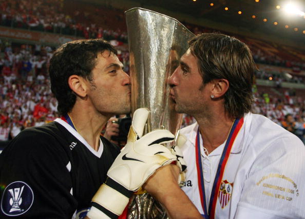 Sevilla players kisse their trophy after