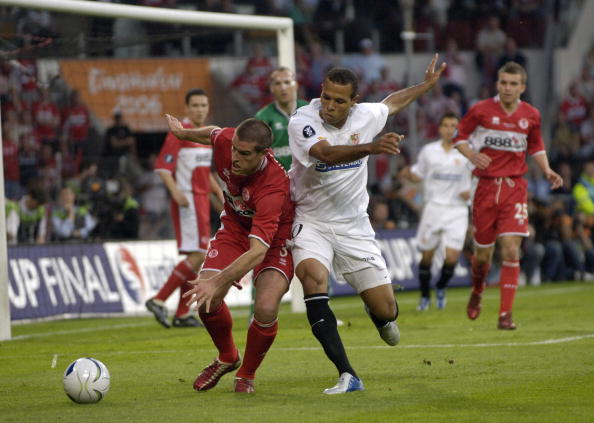 BT Sport. Football. UEFA Cup Final. Eindhoven. 10th May 2006. Middlesbrough 0 v Sevilla 4. Middlesbrough's Franck Queudrue with Sevilla's Luis Fabiano.