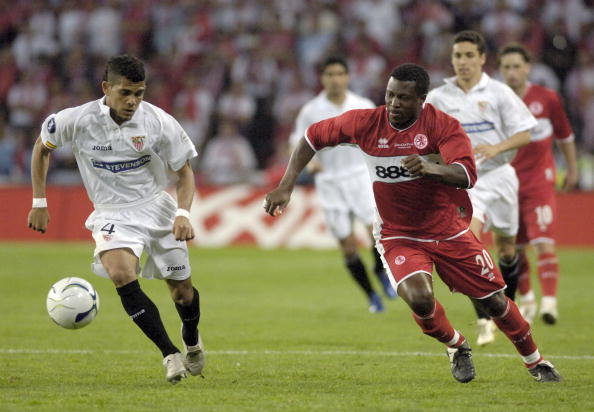 BT Sport. Football. UEFA Cup Final. Eindhoven. 10th May 2006. Middlesbrough 0 v Sevilla 4. Sevilla's Daniel Alves with Middlesbrough's Ayegbeni Yakubu.