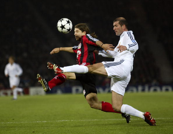 Zinedine Zidane of Real Madrid and Diego Placente of Bayer Leverkusen