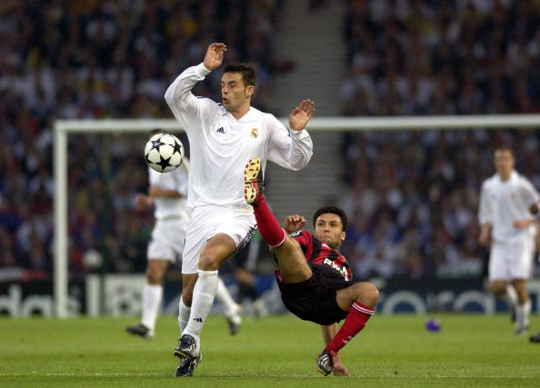 PF Football. UEFA Champions League Final. Hampden Park, Glasgow. 15th May 2002. Real Madrid 2 v Bayer Leverkusen 1. Bayer Leverkusen's Yildiray Basturk tackles Real Madrid's Fernando Morientes.