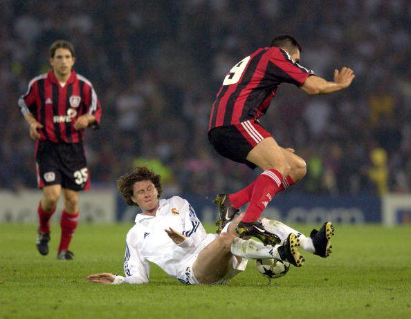 PF Football. UEFA Champions League Final. Hampden Park, Glasgow. 15th May 2002. Real Madrid 2 v Bayer Leverkusen 1. Real Madrid's Steve McManaman tackles Bayer Leverkusen Lucio.