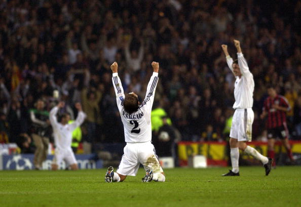 PF Football. UEFA Champions League Final. Hampden Park, Glasgow. 15th May 2002. Real Madrid 2 v Bayer Leverkusen 1. Real Madrid's Michel Salgado falls to his knees in celebration after winning the match.