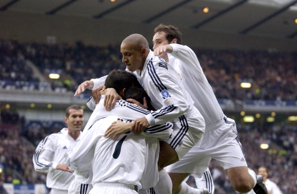 PF Football. UEFA Champions League Final. Hampden Park, Glasgow. 15th May 2002. Real Madrid 2 v Bayer Leverkusen 1. Real Madrid's Roberto Carlos jumps on team mates after Raul scored the opening goal.